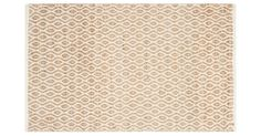 This natural-fiber rug has a cotton border along the edges, which serves to frame the space around it. $449