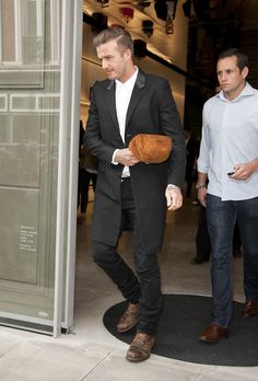 David Beckham stopped by his wife Victoria Beckham's new flagship store in London on Wednesday.
