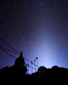 Photo by @babaktafreshi  The World at Night project  Star-filled sky in an early morning of Himalayas in Nepal. The elongated patch of Zodiacal Light appears above a Buddhist stupa near Namche Bazaar on the main trek to Everest base camp. The cone-shaped diffuse glow is the sunlight reflecting from asteroid dust in the Solar System plane visible in dark skies after dusk or before dawn. Have you ever seen it?  Follow me @babaktafreshi to explore our planets night wonders.  #himalaya