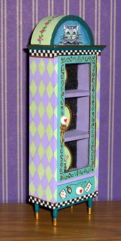The cabinet is signed - Leslie Lassige (that's me!). and dated on the back. Dollhouse Miniature Alice in Wonderland Curio Cabinet & Plates. This whimsical Alice in Wonderland themed curio and matching plates is entirely handpainted with all sorts of fun colors and details. | eBay!