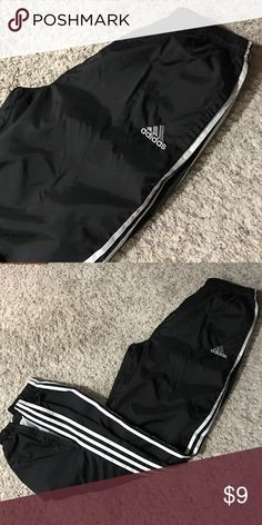 Adidas pant Wind pant lined with cotton elastic waist with a drawstring and elastic ankles with zippers. Slide pockets at sides Adidas Pants Sweatpants & Joggers