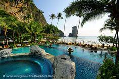 Pool, beach, sea and rock view from Centara Grand Krabi Resort, Thailand.
