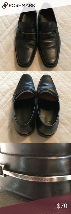 Boss Hugo Boss Men's Black Dress Shoes Loafers 7 Men's black leather formal dress shoes by Boss Hugo Boss.  Leather upper, leather lining, and part-leather sole.  Slip-on loafer style with silver metal designer branding decoration on front.  Excellent pre-owned condition.  Perfect for a wedding, prom, or black tie event. Hugo Boss Shoes Loafers & Slip-Ons