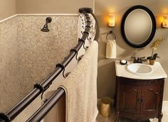 Moen Old world bronze curved shower rod - DN2140OWB