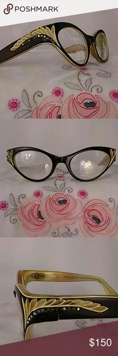 French Couture designer 1940's two tone eyeglasses Rare beautiful pair of SWANK eyeglasses 40s or 50s they are two-tone black and cream colored the feather design at the corners of the cat eye glasses are studded with Aurora Borealis marcasite stones. The glass will need to be changed to your prescription. The plastic is structurally good there is wear and stress cracks but nothing that reduces wearability. I have not attempted to clean this item and I recommend to have it done by a…