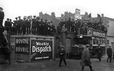 Latecomers at Stamford Bridge manage to get a good view of the match between Chelsea and Tottenham Hotspur (1913).