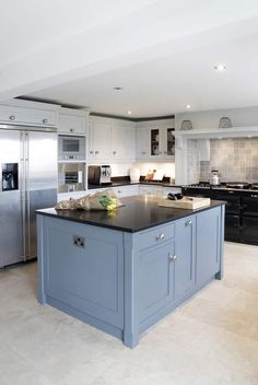 Dual colour scheme. See more of this kitchen at http://woodworkkitchens.co.uk