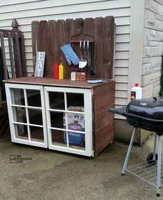 repurposed windows and reclaimed fence make a great barbecue cabinet MyRepurposedLife.com