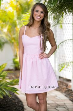 This dress is has simple and sweet written all over it! We love the seersucker design and the color is just perfect for spring!
