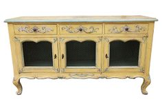 Vintage Italian painted three-door/drawer credenza.  Why yes, I could see me owning this!