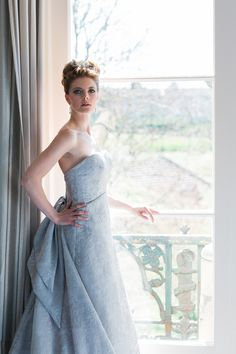 Silver embroidered wedding gown with bow and train back detail, by Christine Trewinnard.