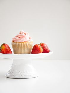 Strawberry Cupcakes with Strawberry Buttercream Frosting. These soft and fruity cupcakes include fresh pureed strawberries for a special dessert for any occasion! | www.chicandsugar.com