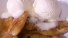 Bananas rolled in brown sugar and cinnamon are grilled until caramelized and served with vanilla ice cream. You can also cook them in a skillet with melted butter.
