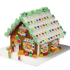 Where the Holidays Live Gingerbread House - Build the house of your dreams—it's easy, in seasonal style of gingerbread Use the Wilton Pre-baked Gingerbread House Kit. Everything is included! Cool Gingerbread Houses, Gingerbread House Designs, Gingerbread Decorations, Christmas Gingerbread House, Outdoor Christmas Decorations, Christmas Treats, Christmas Cookies, Christmas Holidays, Christmas Things