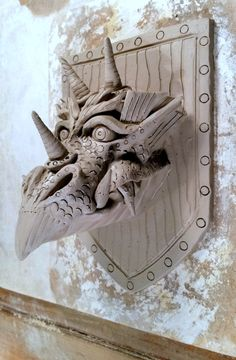 Dragon Hunting Trophy - sculpted in clay, waits for the kiln. Sculpting, Hunting, Lion Sculpture, Clay, Ceramics, Statue, Crafts, 3d, Inspiration
