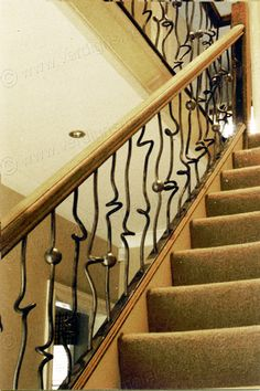 These contemporary and funky metal stair spindles were made by twisting and knotting the steel whilst hot. At very hot temperatures the stee...