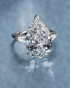 A diamond solitaire ring, 7.04 carats, Harry Winston