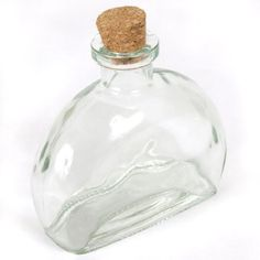 """6 oz Fiji Glass Reed Diffuser Bottle - Clear by Elit Sense Exclusive. $5.00. Height: 4"""". Length: 2"""". Capacity: 6oz / 178ml. Width: 4 1/4"""". Opening: 3/4"""". Looking for replacement bottle or just need a reed diffuser bottle for our Reed Diffuser Scented Oil Refills? Look no further! This 6 oz Clear Fiji Glass Bottle is a great choice. Comes with cork and holds up to 6 oz of liquid.. Save 17% Off!"""