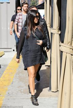 Entourage: Kourtney was followed by Scott and a team who kept close by her as she walked t...