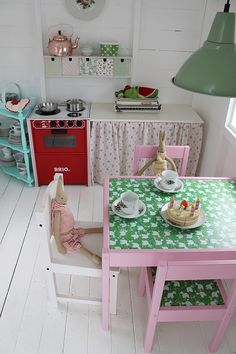 inside a DIY painted play shed for girls. Do you need some childrens shed ideas? Make your own little playhouse for your kids & paint it in bold, bright colors. This little painted play shed/kids hut is adorable and would look fabulous in your garden! Playhouse Interior, Build A Playhouse, Garden Playhouse, Childs Playhouse, Painted Playhouse, Girls Playhouse, Play Kitchens, Cubby Houses, Play Houses
