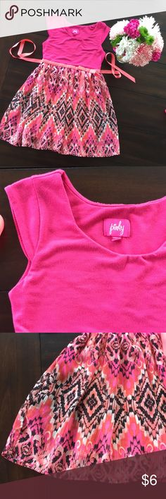 Cute and comfy spring dress Spring dress.   Cute and comfy.  Consists of pink,orange and black colors as seen in pictures.  Has tie for back or front.  In good used condition and also has lining/slip underneath.  Tag states size 6. Bundle for discount. Pinky Dresses Casual