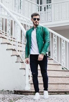For a comfortable-as-your-couch outfit, consider wearing a green leather bomber jacket and navy ripped jeans. White low top sneakers will add a touch of polish to an otherwise low-key look.
