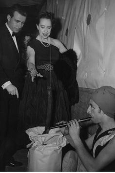 Elsa Schiaparelli * at an exhibition of snake charming at the annual ball of the Paris School of Fine Arts, held on June 11, 1949