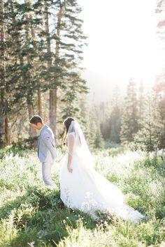 Bride and groom walking through albion basin in Utah // Fine Art Utah Wedding Photographer