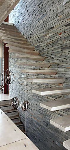 Floating wooden stairs on drystone wall