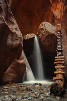 Small waterfalls in the narrows section of Kanarra Creek, at Kanarraville, Utah - Robin Black Photography - Paradise for photographers in every time of the year. If you are one, this is the place to be. Pack your bags and explore the small waterfalls in Utah before the cold air hit the region. #Utah #KanarraCreek #USA