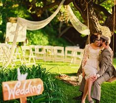 Would consider this for a backyard party without the wedding sign.  Love the swing idea. and color bottles with lights in the trees, good music and good friends could be amazing!