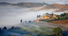 Early morning fog in Crete Senesi, Italy
