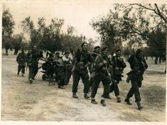– Μέγαρα – A mortar team from the Parachute Battalion look happy as they pull equipment – The 4, Greece, Film, Outdoor, War, Happy, Greece Country, Movie, Outdoors