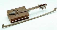 """Unusual Instruments Creole musician Joseph """"Bebe"""" Carriere of Lawtell, Louisiana, made this fiddle using a cigar box. South Louisiana Cigar Box and Wood"""