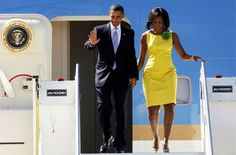 Barack and Michelle going down the presidential plane.