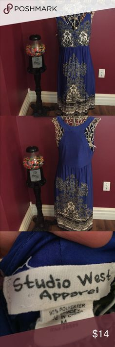 Studio West Apparel dress Studio west apparel dress pretty cool about blue color 44 inches in length approximately mid calf length. Comfy material that would pack well Studio West Apparel Dresses