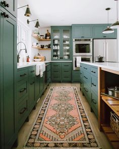 Take your kitchen to the next level by painting your cabinets an Insta-worthy color like this beautiful green. #InMyDomaine | design:…