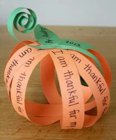 Thankful Pumpkin Craft-orange & green paper, staples, scissors.  Cut out 8 pc of orange paper into 1 inch strips.  Cut out 2 leaves and 2 skinny strips of green paper for the vines. Write what they are thankful for on each strip of orange paper.  Be sure to leave about a 1 inch space on the sides of the strip so the writing isn't covered up when stapled together. Use a stapler to attach the orange strips at the top and then at the bottom to form a pumpkin. Add your leaves and green vines.