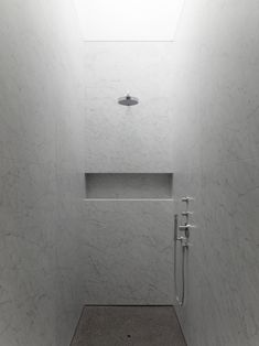 what about large pieces of carerra for the entire shower walls