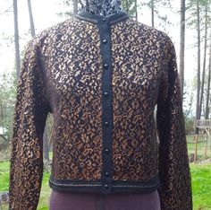 Check out this item in my Etsy shop https://www.etsy.com/listing/286515353/copper-lace-50s-cardigan