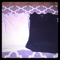 Two size M American Eagle tee shirts. Black/Grey Two American Eagle teeshirts. Both size M. One is a 100 % cotton grey V neck. Other is a black scoop neck. Neither have any rips tears or stains. American Eagle Outfitters Tops Tees - Short Sleeve