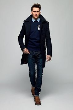Men's Brown Leather Brogues, Navy Jeans, Navy Crew-neck Sweater, Blue Dress Shirt, and Navy Pea Coat