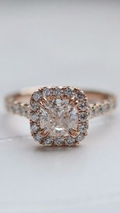 love this halo diamond ring in rose gold