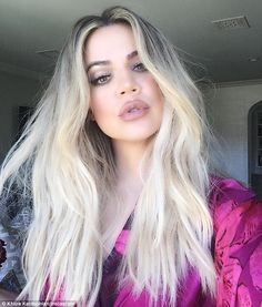 Effortless beauty: Khloe Kardashian revealed the simple secrets behind her beautiful skin on her app on Tuesday - Bio-Oil and Vitamin E on her face plus Aquaphor on her eyes