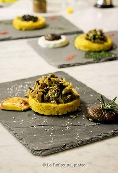 Menu prepared by Chef Denny Bruci (Poggio ai Santi, Tuscany). Polenta integrale con carciofi servita su lastre di ardesia. Whole corn polenta with artichokes served on slate dishes.