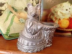 This is a very beautiful and unique Kirk Stieff pewter mouse (church mouse or country mouse) candle holder or perhaps small vase. It is marked Kirk