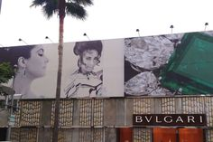"""Bulgari on Rodeo Drive showcased a collection of Elizabeth Taylor's jewels today, with a private """"Bulgari Jewels"""" event set for this evening. In celebration, the boutique exterior is covered in images of Taylor and her stunning pieces."""