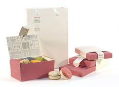 "Absolutely ADORE the newspaper print on the interior of the package. Love everything about this.  ""This is a packaging project to design a range of ""packs"" that can house the macaroons and chocolates produced by Café Vue."" Designed by Kim Hei Ip 