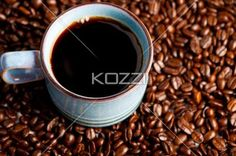 coffee mug and beans - Coffee mug with coffee beans surrounding it.