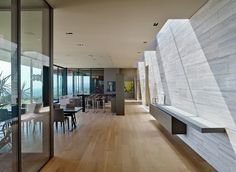 Several rectangular skylights throughout the home contribute to balancing the light within the main living spaces.